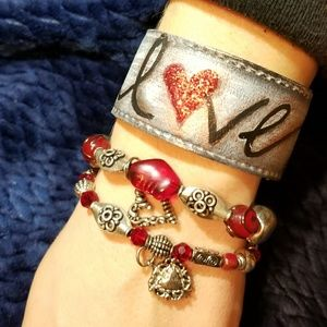Leather cuff and Crystal bracelets.